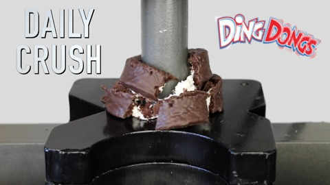Crushing a cupcake with hydraulic press