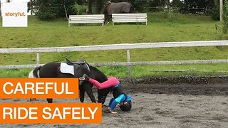 Gentle Pony Helps Girl Who Falls Off After Fence Jump - Video