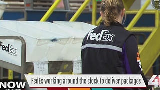 FedEx working around the clock to deliver packages - Video
