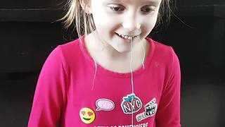 Brave Little Girl Pulls A Loose Tooth With Remote-Controlled Truck - Video