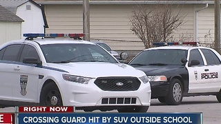 Crossing guard hit by SUV outside school - Video