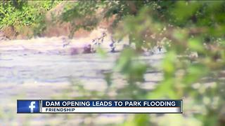 Dam opening leads to park flooding - Video