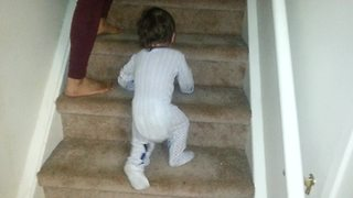 Baby demonstrates comically unique way of climbing stairs