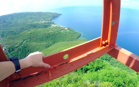 Crazy teen climbs radio tower in the Caribbean