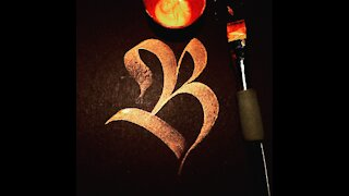 Calligraphy letter B with a brush