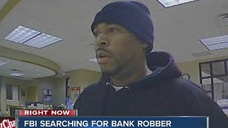 FBI searching for man who robbed Indianapolis bank - Video