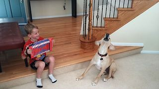 Cute Kid And Dog Duo Sing Their Hearts Out