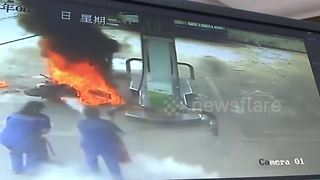 Motorbike bursts into flames at petrol station - Video