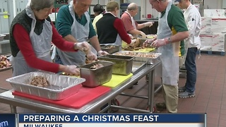 Salvation Army volunteers prep food to feed thousands on Christmas Day - Video