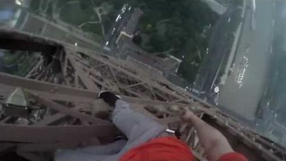 Pair of Daring Dudes Climb the Eiffel Tower - Video
