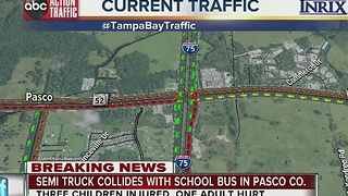 Semi truck collides with school bus in Pasco Co.