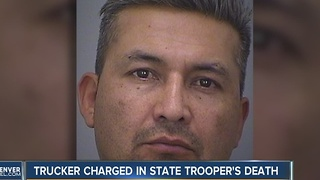 Trucker charged in trooper's death - Video