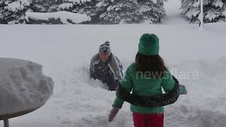Father and daughter bellyflop into 4ft of snow in Erie, Pennsylvania - Video