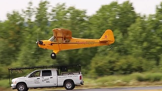 Pilot lands airplane on top of a moving truck - Video