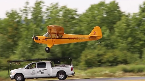 Pilot lands airplane on top of a moving truck
