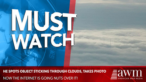 During Flight Man Spots Object Sticking Through Clouds, Takes Photo. Now It's Going Viral