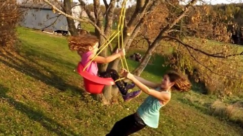 Creative dad builds epic bungee swing for daughters