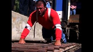 Strongman Pulls Train - Video