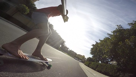 Bombing Hills on a Clear Longboard Skateboard Barefoot