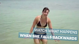 She Told Us To Watch Her Fall Backwards Into The Water, But Make Sure To Watch Her Closely - Video