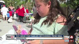 Veterans give 300 children early Christmas presents in Immokalee - Video