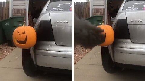 INVENTIVE SPIN ON JACK-O-LANTERNS AS THIS MOTORIST ATTACHES HIS PUMPKIN TO HIS SMOKEY EXHAUST