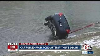 Father dies after rescuing child from vehicle after it plunges into pond on Indy's north side - Video