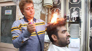 Indian barber sets hair on fire to give a great haircut - Video