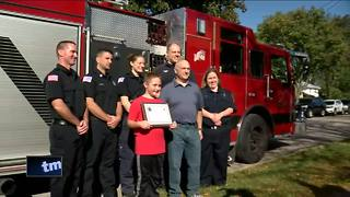10-year-old boy who saved father honored - Video