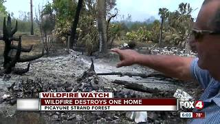 Man loses trailer home to wildfire - Video