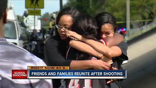 Friends and families reunite after Parkland school shooting - Video
