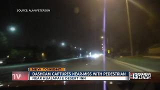 Dash-cam captures near-pedestrian miss on video