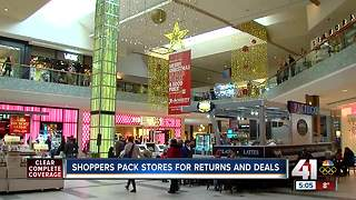 Shoppers pack stores for returns and deals - Video