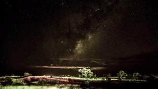 Clouds Pass Under Swirling Galaxy in Gorgeous Pilbara Timelapse - Video