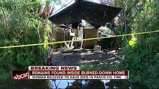 Remains found inside burned-down home - Video