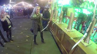Nicola Hughes tires to shoot bow at Winter Wonderland - Video