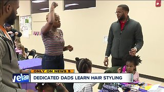 Daddy daughter hair care class teaches dads how to braid child's hair