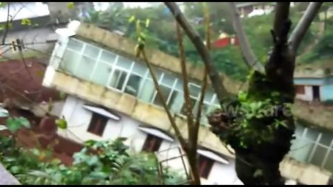 Three-story house slips down hill during landslide