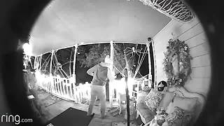 Surveillance video of thief stealing Halloween decorations on camera - Video