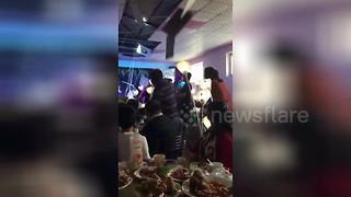 Bride's bouquet toss causes ceiling to collapse on top of guests - Video