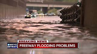 Heavy rain triggers flooding on metro Detroit freeways - Video