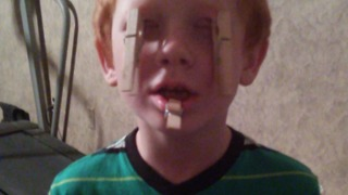 Young Boy Tries Clothespin Challenge - Video
