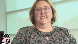 Michigan Lottery awards teacher with award - Video