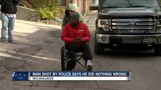 Man shot by police says he didn't have a gun - Video