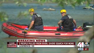 2 people pulled from river, divers search for other possible victims - Video