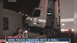 Semi truck plows through neighborhood entrance - Video
