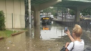 Bus Stuck on Flooded Istanbul Street in Aftermath of Torrential Rain - Video