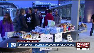 More than 100 education supporters rally in Brookside - Video