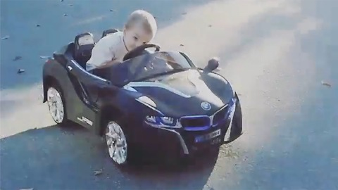 3 Year old does donuts in his BMW
