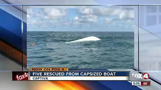Boaters rescued from capsized boat - Video